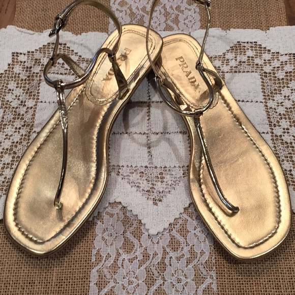 b16c73dafbf Prada Women s Flat Thong Sandals Gold Size 38. M 5a3abc898af1c54afc04d699